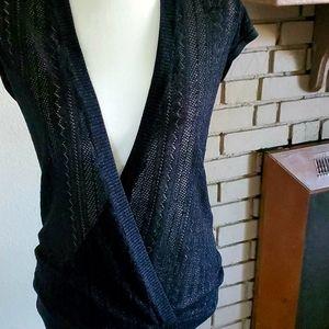 Slinky black over shirt.